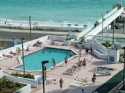 Front Corner Condo with 50 balcony overlooking the Gulf - Large heated pool, kiddie pool, 2 large spas