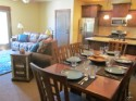 Utah - Aloha Bear Condo - The dining room is open to the living room and kitchen for an open feel.